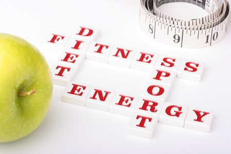 Creative on a theme of a healthy way of life. From ceramic letters the combination of words fitness, a diet, energy and sports is collected.