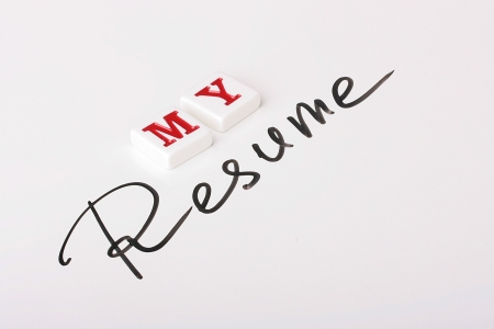resume: The Resume word is written by a marker on a white surface and nearby the word My, made of ceramic letters is placed.