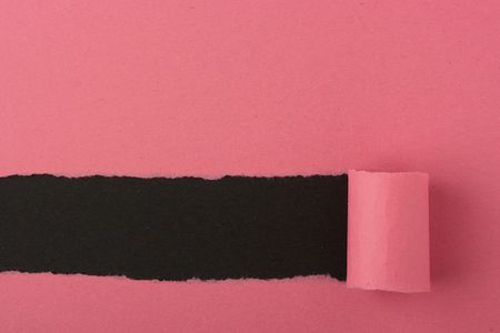 The background consisting of pink and black colour, pink is broken off and in rupture the bottom black layer.