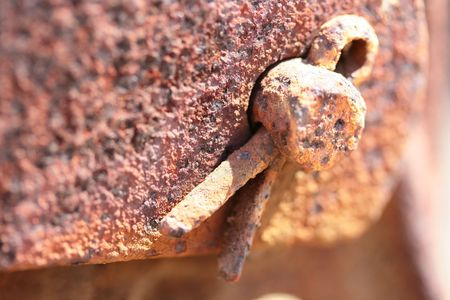 Old rusty metal detail fixed splay piece. Imagens - 7365715