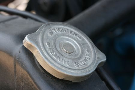 Metal cover on an old radiator for engine cooling. photo