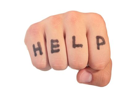 On a mans fist word Help is written.