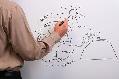 ozone: Man in a brown shirt drawing what could happen to the earths ozone layer.