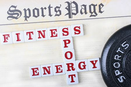 Sports page with a crossword puzzle combined from words fitness, sports and energy. Фото со стока