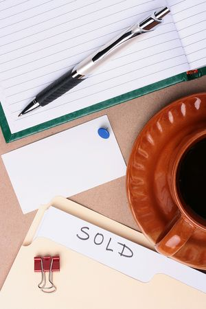 A pinned business card next to a cup of coffee and office supplies. Add your text to the card. Stock Photo - 7477537