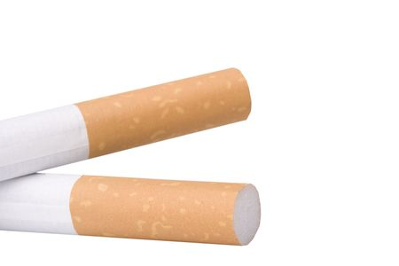 Two filtered cigarettes isolated on a white background. Stock Photo