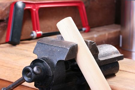Vice in a metalwork workshop with a wooden whetstone.
