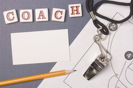 coach: A silver whistle on a basketball diagram next to the word coach. Add your text to the white space. Stock Photo
