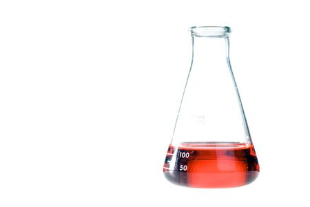 Red liquid in a clear erlenmeyer flask isolated on a white background.