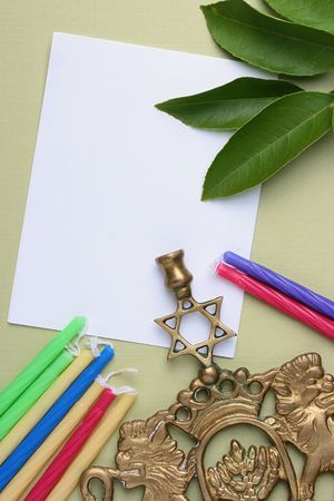simchat torah: Menorah and candles next to a piece of white paper. Add your text to the paper. Stock Photo