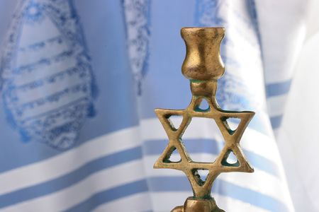 Menorah in front of a blue and white tallit. Add your text to the background. photo