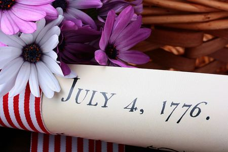 The ancient text of the declaration on independence of the United States of America with a casket and a feather for the write. Stock Photo - 7605802