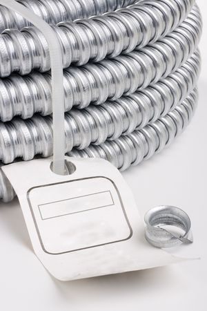 Metal cable protection conduit on a white background