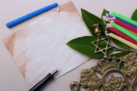 Menorah and candles next to an old piece of paper. Add your text to the paper. Stock Photo - 7671486