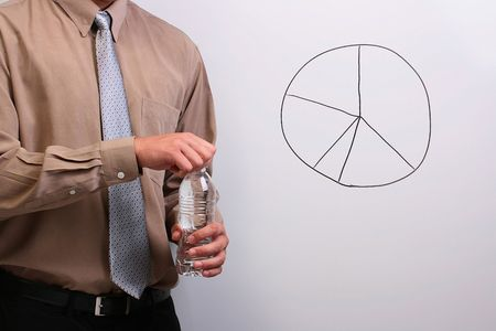 Man in a shirt and a tie opening a bottle of water while standing next to a drawing of a pie chart. Stock Photo - 7671491