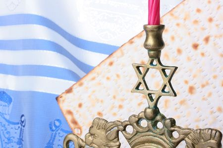 Menorah and matzah in front of a blue and white tallit. Add your text to the background. photo