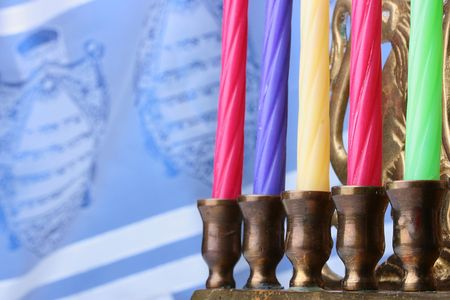 Menorah candles in front of a blue and white tallit. Add your text to the background. photo