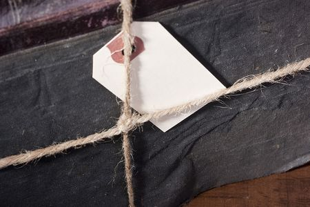 archival: Archival book in a book-depository are tied up by a cord. Stock Photo