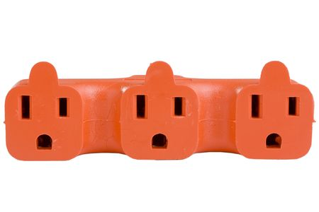 surge: Orange outlet surge adapter isolated on a white background.