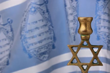 yom kippur: Menorah in front of a blue and white tallit. Add your text to the background.