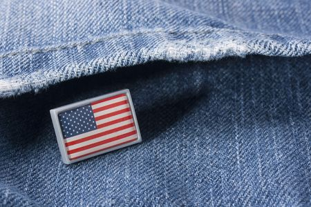 Flag of the USA against a pocket of dark blue jeans trousers. Stock fotó