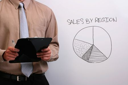 Man in a shirt and a tie explaining a drawing of a pie chart with a clipboard in his hands. Stock Photo - 7845206