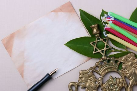 simchat torah: Menorah and candles next to an old piece of paper. Add your text to the paper. Stock Photo