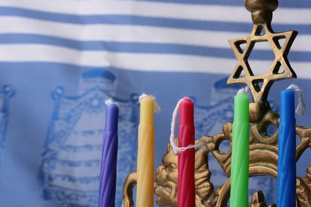 simchat torah: Menorah candles in front of a blue and white tallit. Add your text to the background.