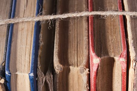 archival: Archival books in a book-depository are tied up by a cord.