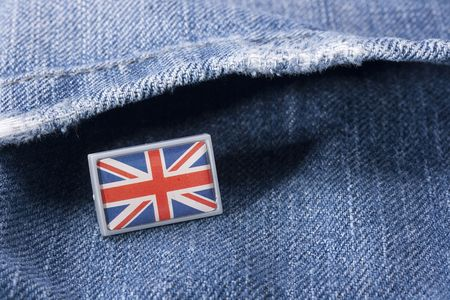Flag of Great Britain against a pocket of dark blue jeans trousers.