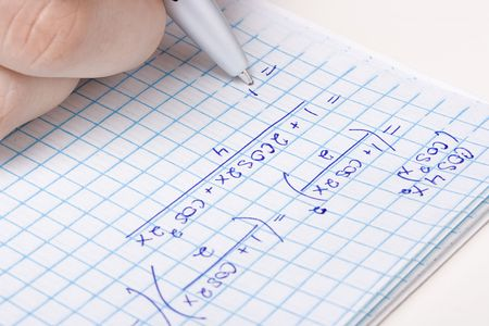 notebook: Student solving a mathematic problem in a notebook.