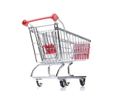Empty shopping cart with the red handle on a white background. Stock Photo - 7933136