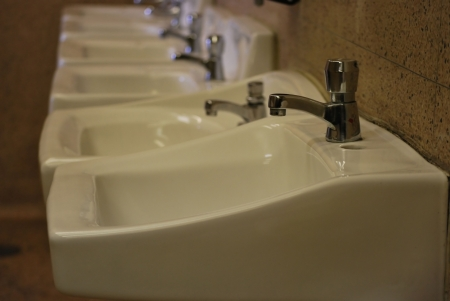 Sinks for washing hands in a public toilet. photo