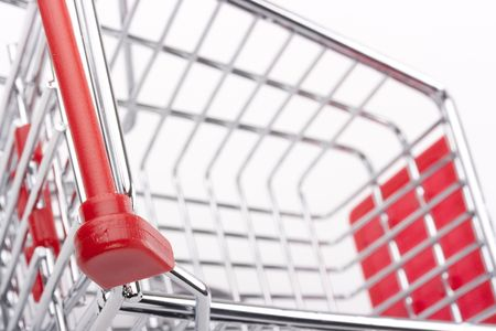 Empty shopping cart with the red handle on a white background. Stock Photo - 7933317