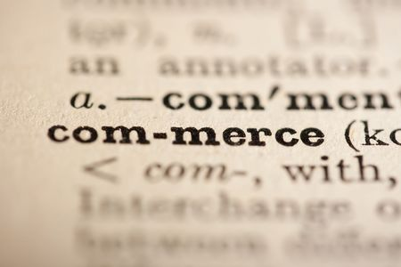 commerce: Word commerce from the old dictionary, a close up. Stock Photo