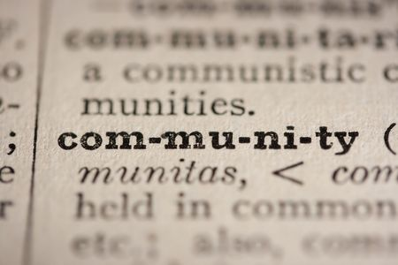 Word community from the old dictionary, a close up. Stock Photo - 8006953