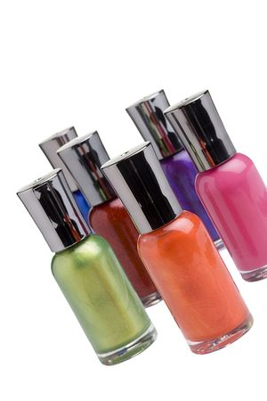 nail polish bottle: Nail polish bottles placed in front of a white background. Stock Photo