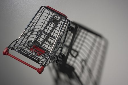 Shade from empty shopping cart with the red handle. Stock Photo - 8006973