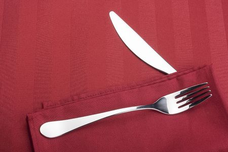 Knife and fork on a napkin as a dining room serving. Stock Photo - 8007037