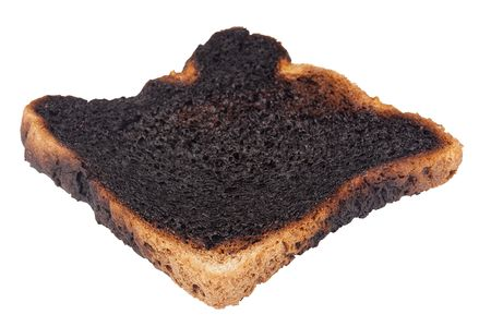 charred: Charred toast after a long stay in the toaster.
