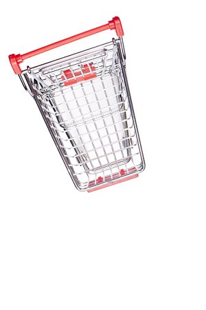 Empty shopping cart with the red handle on a white background. Stock Photo - 8075279