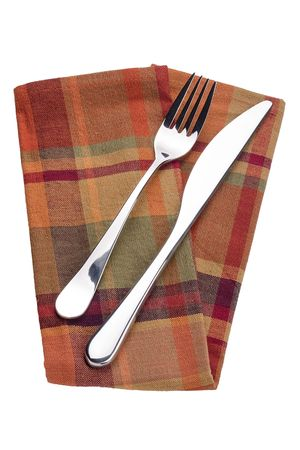 Knife and fork on a red napkin - tableware. Stock Photo - 8075306