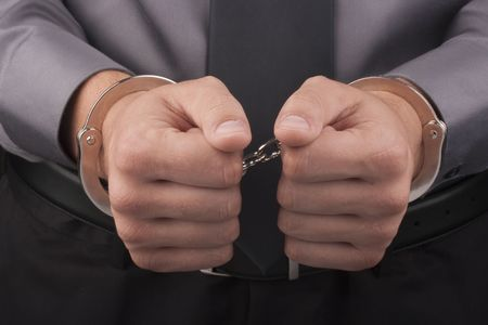arrestment: Arrest, close-up shot mans hands with handcuffs.