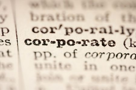 pronunciation: Word corporate from the old dictionary, a close up.