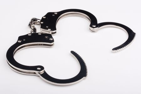 disclosed: Disclosed iron handcuffs on a white background.