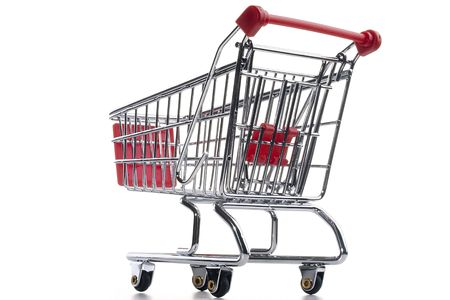 Empty shopping cart with the red handle on a white background. Stock Photo - 8075360