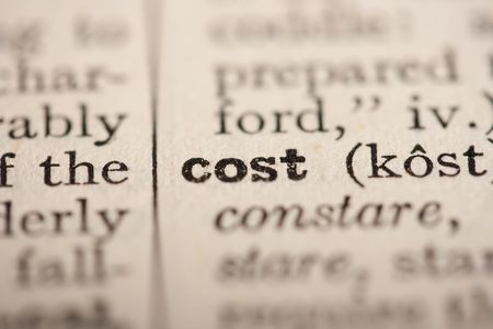 Word cost from the old dictionary, a close up. photo