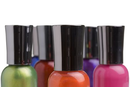 nail polish bottle: Different colored nail polish bottles placed in front of a white background. Stock Photo