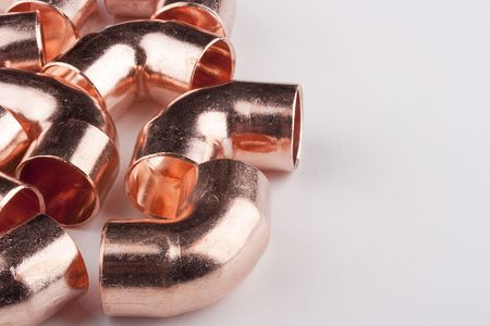 Copper accessories designed for mounting the water distribution system. Stock Photo - 8133255