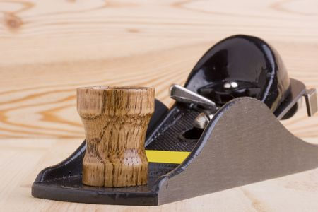Woodworking handplane on a piece of wood. Stock Photo - 8133252